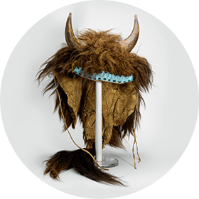 Image of a ceremonial headdress with two horns and buffalo fur
