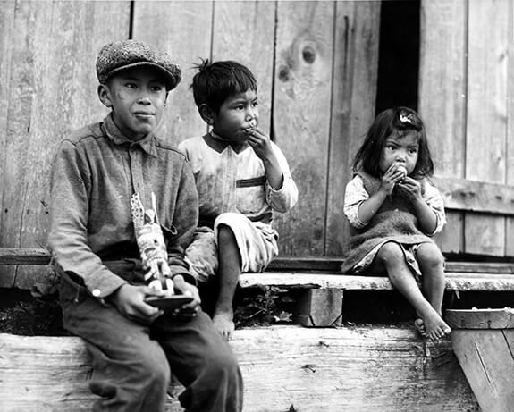 Old picture of three Nuu-chah-nulth (Nootka) children at Friendly Cove, British Columbia