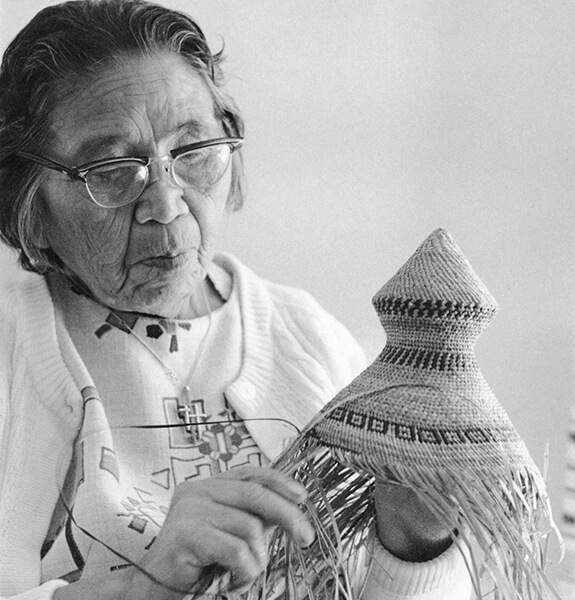 Picture of a woman making a traditional hat