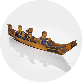 Picture of a scale model watercraft with Nuu-chah-nulth (Nootka) people onboard