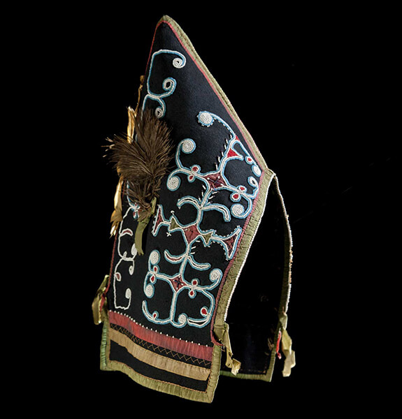 Picture of a Mi'kmaq woman cap adorned with double-curve beaded motifs.