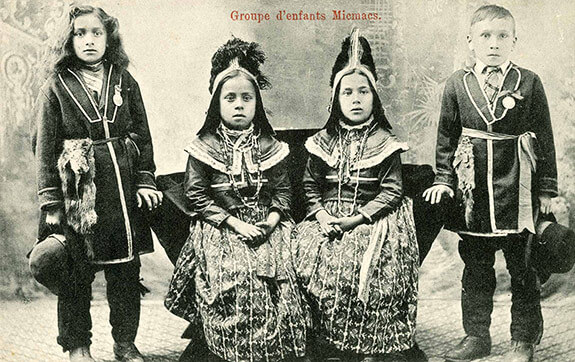 Postcard showing Mi'kmaq children dressed in traditional ceremonial clothes