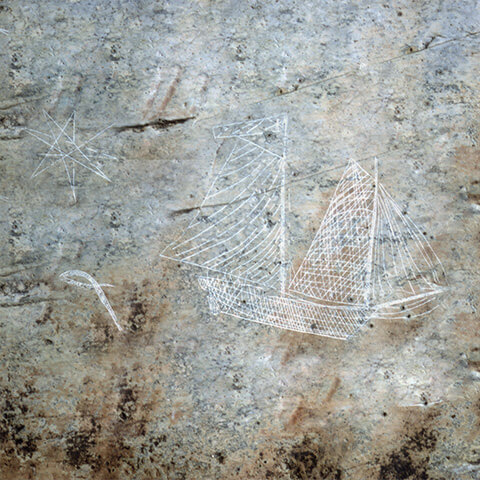 Picture of petroglyphs illustrating a sailing ship, a sea snake and a star