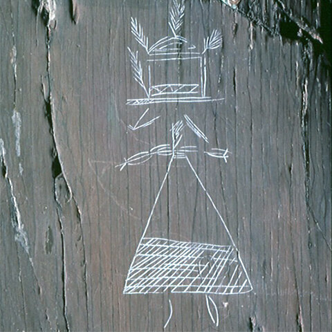 Picture of a carving illustrating most likely a female figure wearing a dress and a high hat