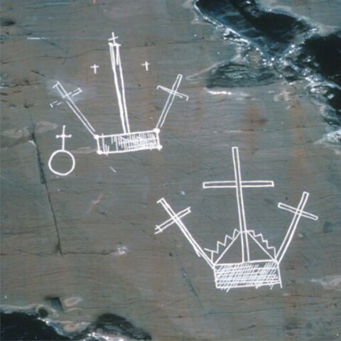 Picture of petroglyphs featuring crosses on two rectangular bases