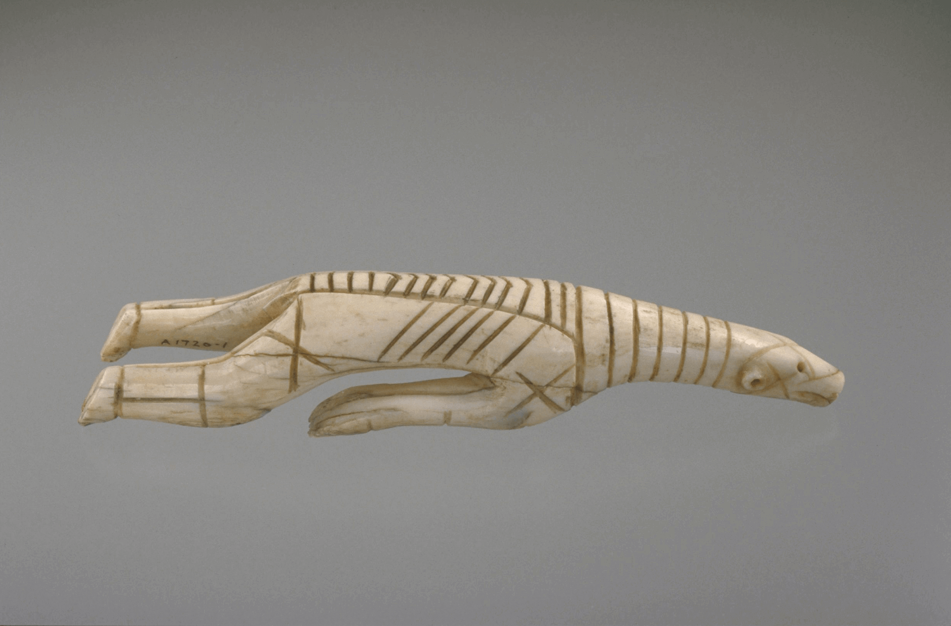 Photograph of the Dorset walrus ivory sculpture of a polar bear