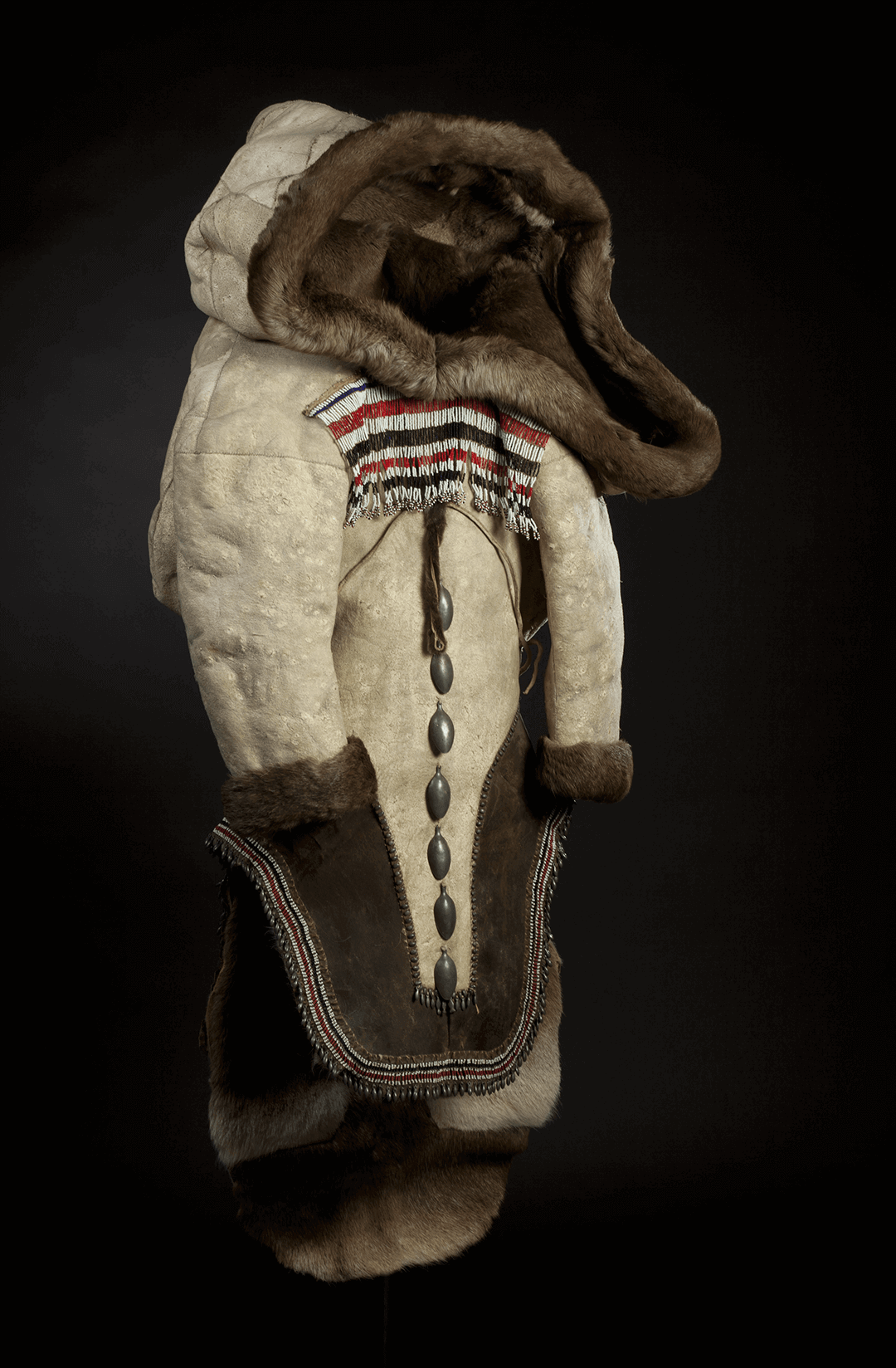 Photograph of women's clothing called Amauti by the Inuit. Made of caribou and ringed seal skins, it is fur-lined.