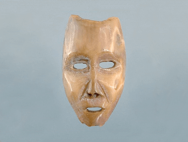 Photograph of a Dorset walrus ivory miniature mask