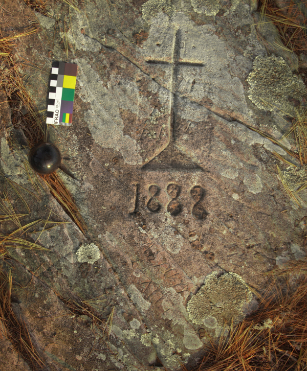 Picture of a rock carving showing a cross and the date of 1888 at the Miller's Mountain site, Nova Scotia, Canada