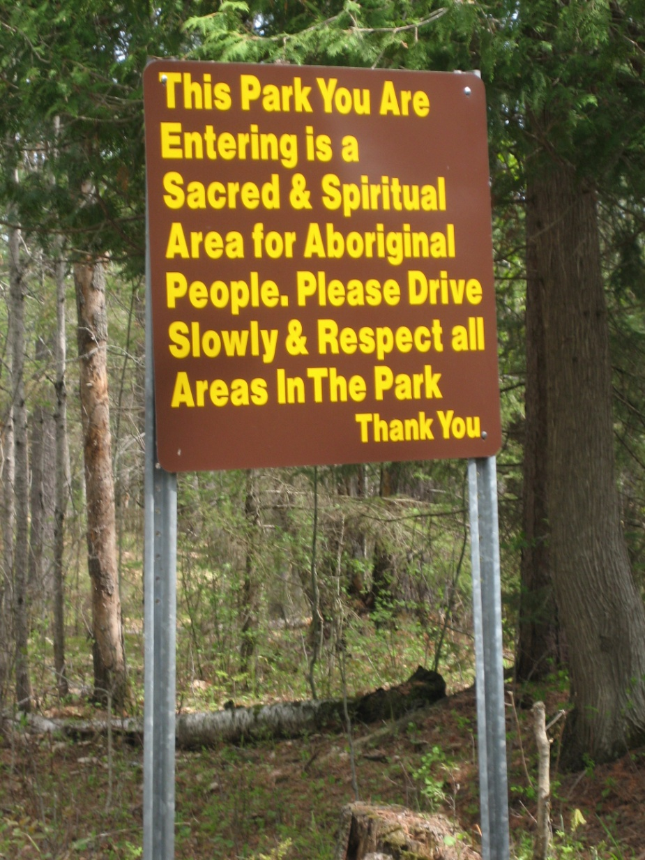 Picture of a panel at the entrance to the Petroglyphs Provincial Park, reminding visitors that the Park is a spiritual and sacred site to Indigenous peoples