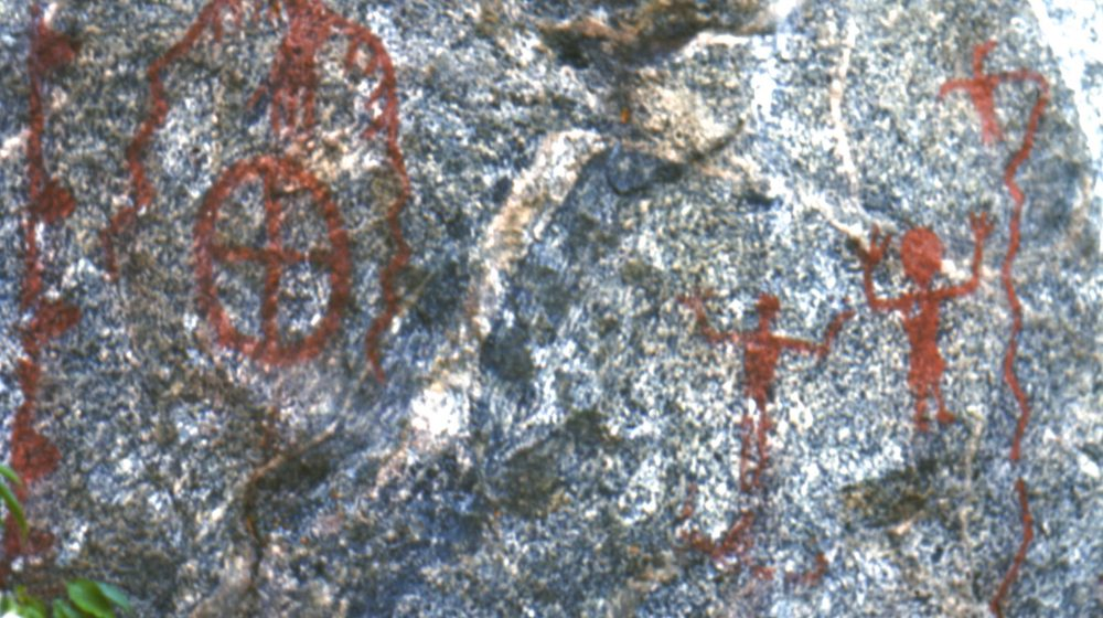High Rock Narrows, Saskatchewan. Image representing several paintings, including a bird with long sinuous wings, two anthropomorphs with raised arms and a circle with a cross inside.