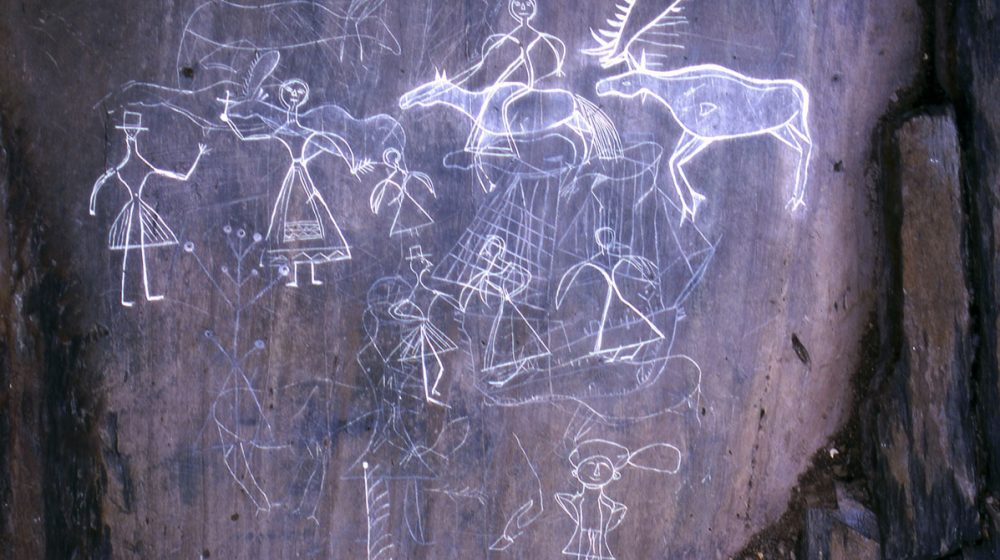 McGowan Lake, Nova Scotia. Petroglyphs depicting a woman riding a moose turned into a horse, a ship and several human figures dressed in 19th century Mi'gmaq clothing.